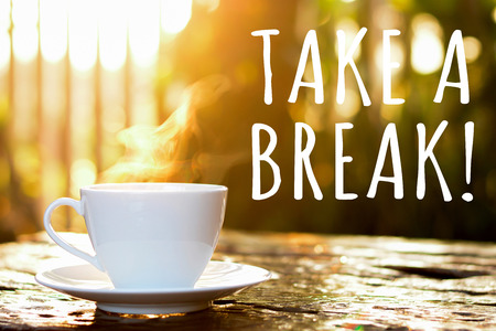 break: TAKE A BREAK text with coffee cup in blur bokeh of morning sunlight background - coffee break poster