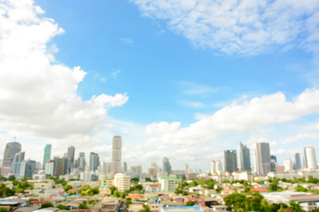 city buildings: Blurred image of buildings in the city with blue sky and clouds as background - Bankgkok, Thailand Stock Photo