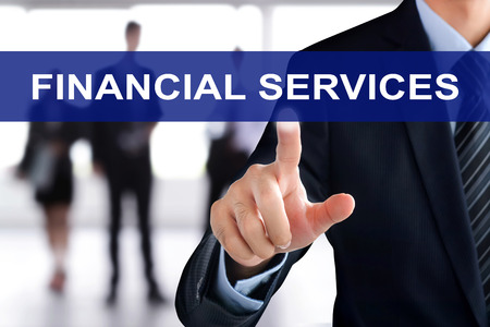 planner: Businessman hand touching FINANCIAL SERVICE sign on virtual screen
