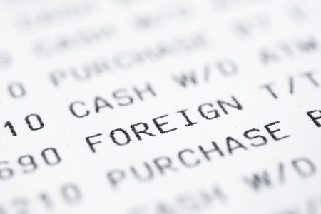 bank statement: Close up of text on bank statement, focused on the word FOREIGN