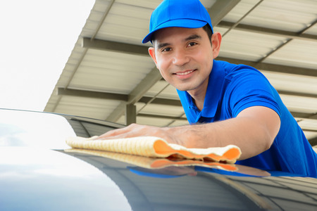 rags: A man polishing car with microfiber cloth, car detailing (or valeting) concept