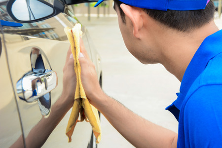 wash: A man polishing car with microfiber cloth, car detailing (or valeting) concept