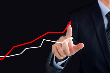 financial graph: Businessman hand touching rising graph on virtual screen - business, financial and investment success concepts Stock Photo