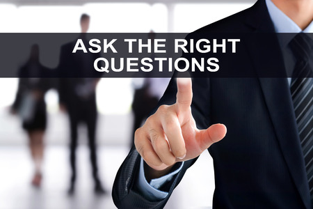 right on: Businessman hand touching ASK THE RIGHT QUESTIONS tab on virtual screen