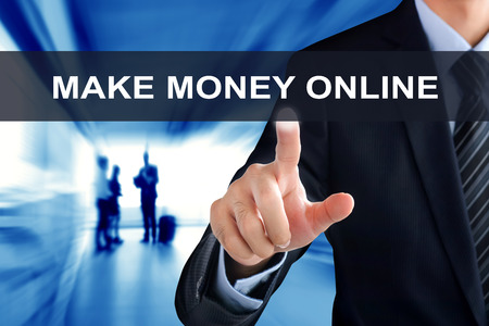 future earnings: Businessman hand touching MAKE MONEY ONLINE tab on virtual screen Stock Photo