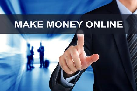 money online: Businessman hand touching MAKE MONEY ONLINE tab on virtual screen Stock Photo