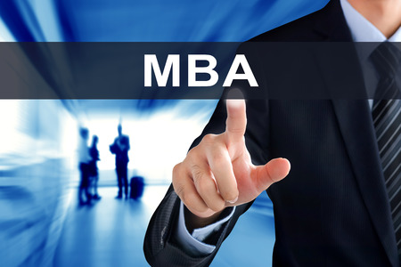 business administration: Businessman hand touching MBA (or Master of Business Administration ) sign on virtual screen