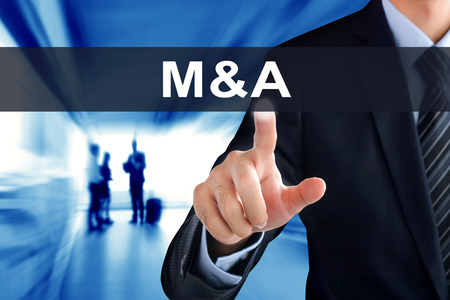 acquiring: Businessman hand touching M & A (Merger and Acquisition) tab on virtual screen