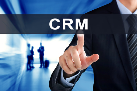 crm: Businessman hands touching CRM  (or Customer Relationship Management) tab on virtual screen