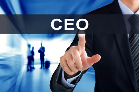 chief executive officers: Businessman hand touching CEO (or Chief Executive Officer) tab on virtual screen