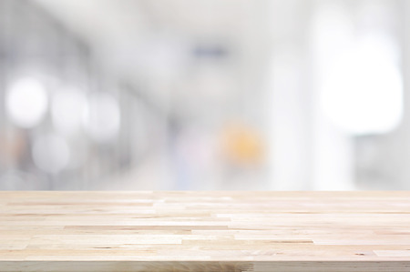 wooden desk: Wood table top on blurred white gray background from hallway - can be used for display or montage your products
