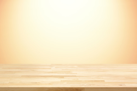 beige backgrounds: Wood table top on gradient beige background - can be used for display or montage your products
