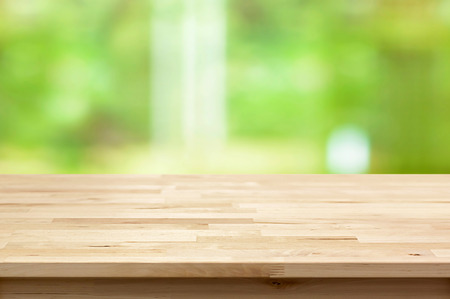 montage: Wood table top on blur green background - can be used for montage or display your products
