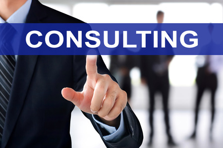 consulting: Businessman hand touching CONSULTING sign on virtual screen