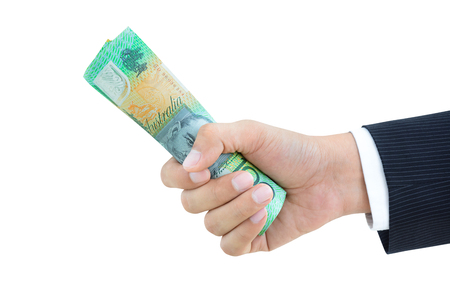 australian dollars: Businessman hand giving roll of money, Australian dollars (AUD), on white background Stock Photo