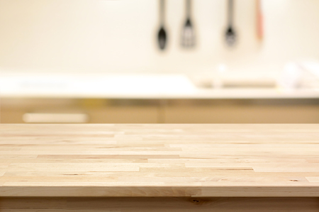 kitchen counter top: Wood table top (as kitchen island) on blur kitchen background - can be used for display or montage your products