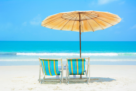 chairs: Blue sea and white sand beach with beach chairs and umbrella, Samed island, Thailand - summer holiday and vacation concepts