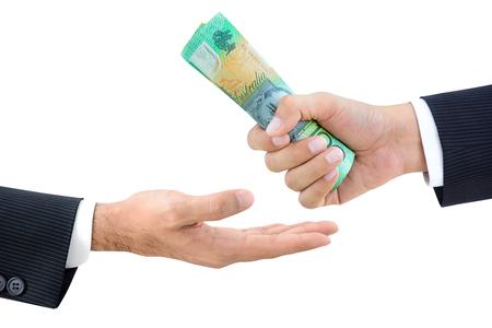 australian dollars: Hands of businessmen passing money, Australian dollars (AUD), isolated on white background