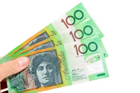 australian dollar notes: Hand holding money, Australian dollar (AUD) banknotes, isolated on white background Stock Photo