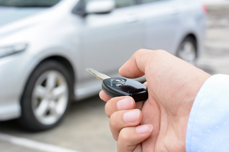 hand press: A man hand about to press button of remote control car key