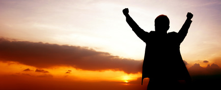 success man: Silhouette of a man raising his arms on twilight sky panoramic (or header) background  - success, winning & accomplished  concepts