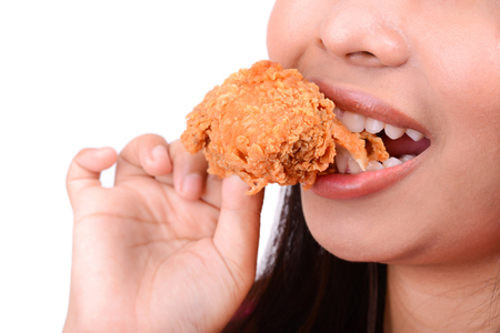 yummy: Woman eating fried chicken, on white background