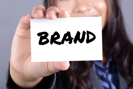 brands: BRAND word on the card shown by businesswoman