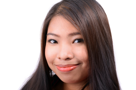 young woman face: Smiling Asian woman isolated on white background Stock Photo