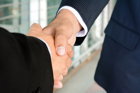 handclasp: Handshake of businessmen - greeting, dealing, mergers and acquisition concept