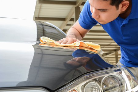 microfiber cloth: A man cleaning car with microfiber cloth Stock Photo