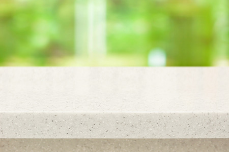 granite slab: White quartz stone countertop on blur green background - can be used for display or montage your products