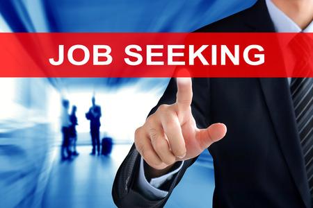 hand job: Businessman hand touching JOB SEEKING sign on virtual screen Stock Photo