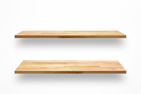 Empty wooden wall shelves on white background