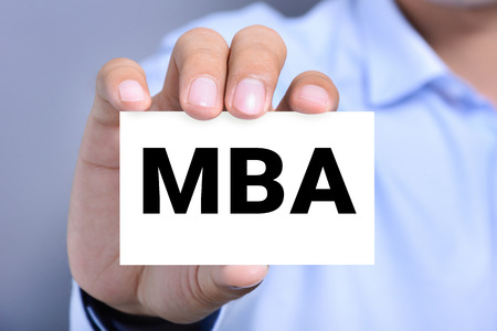 business letters: MBA letters (or Master of Business Administration) on the card held by a man hand