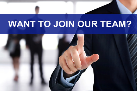 join the team: Businessman hand touching WANT TO JOIN OUR TEAM? message on virtual screen Stock Photo