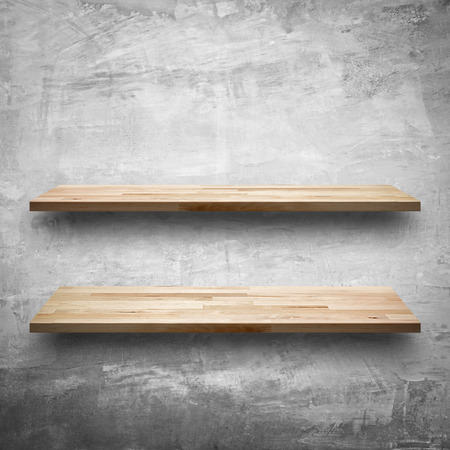 furniture shop: Empty wooden shelves on concrete wall background Stock Photo