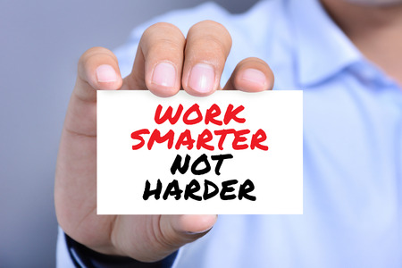 harder: WORK SMARTER NOT HARDER,  motivational text message on the card shown by a man