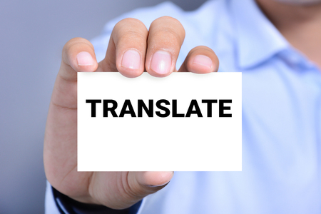 interpret: TRANSLATE word on the card held by a man hand