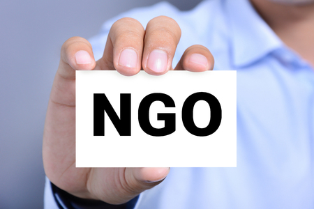 ngo: NGO letters (or Non-Governmental Organization) on the card shown by a man