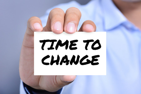 TIME TO CHANGE, message on the card shown by a man