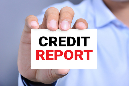 lender: CREDIT REPORT message on the card shown by a man