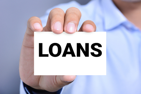 loans: LOANS word on the card shown by a man Stock Photo