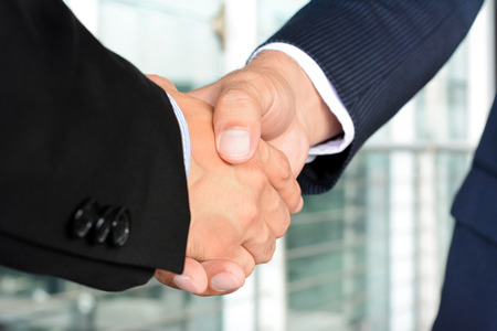 acquisition: Handshake of businessmen - greeting, dealing, mergers and acquisition concept