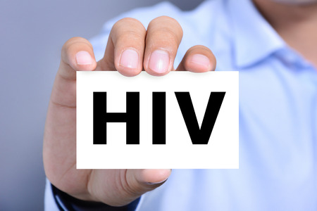 sick person: HIV letters (or Human Immunodeficiency Virus) on the card shown by a man