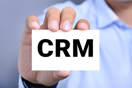crm: CRM letters (or Customer Relationship Management) on the card shown by a man