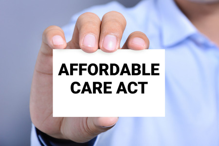affordable: AFFORDABLE CARE ACT (or ACA) message on the card shown by a man