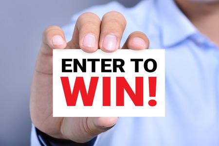 ENTER TO WIN!, Meldung auf der Karte von einem Mann die Hand