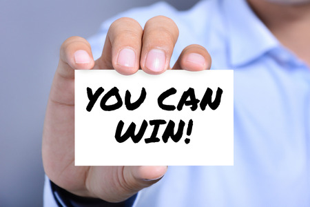 stamina: YOU CAN WIN !, message on the card held by a man hand Stock Photo