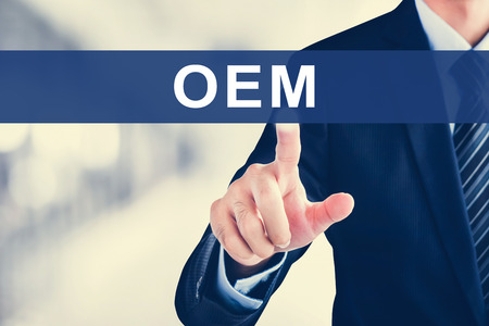 manufacturer: Businessman hand touching OEM (or Original Equipment Manufacturer) text on virtual screen Stock Photo