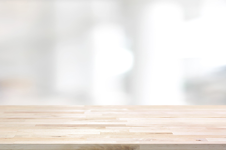 Wood table top on white blurred abstract background from building hallway  - can be used for display or montage your products 스톡 콘텐츠